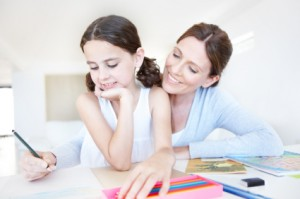 A mother and daughter working on homework together
